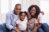 Happy family smiling at camera together — Stock Photo