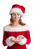 Pretty woman in santa costume presenting your product — Stockfoto