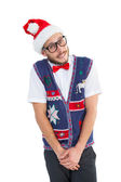Geeky hipster in santa hat — Stockfoto