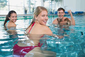 Fitness class doing aqua aerobics — Stockfoto
