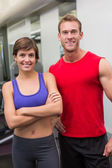 Fit attractive couple smiling at camera — Stock Photo