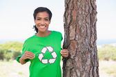 Pretty environmental activist showing her t-shirt — Stock Photo