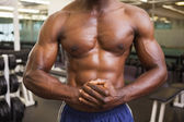 Mid section of a shirtless muscular man in gym — Stock Photo