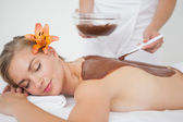Beautiful blonde enjoying a chocolate beauty treatment  — Stock Photo
