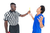 Serious referee showing yellow card to player — Stock Photo