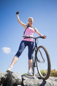 Cyclist on a rocky terrain smiling — Stock Photo
