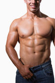 Mid section of a shirtless muscular man — Stock Photo