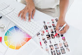 Photo editor working on contact sheet — Stock Photo