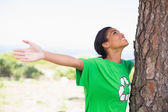 Pretty environmental activist looking up at tree  — Stock Photo