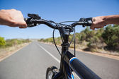 Cyclist hitting the open road — Stock Photo