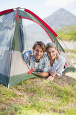 Couple smiling from inside their tent — Foto de Stock