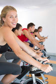 Blonde smiling at camera during spin class — Stock Photo