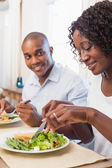 Happy couple enjoying a healthy meal together  — Stock Photo