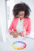 Casual graphic designer working at her desk sketching  — Stock Photo