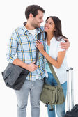 Attractive young couple going on their holidays — Stockfoto