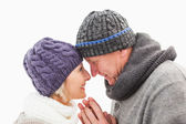 Happy mature couple in winter clothes embracing — Stock Photo