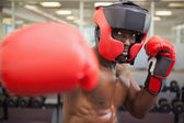 Male boxer attacking with his right — Stock Photo
