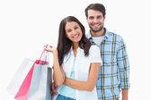 Casal jovem e atraente com sacos de compras — Foto Stock
