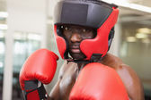 Male boxer in defensive stance — Stock Photo