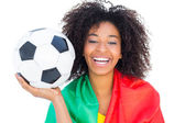 Pretty football fan with portugal flag holding ball — Foto de Stock