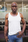 Serious muscular man in gym — Stock Photo