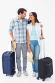 Attractive young couple going on their holidays — Stock Photo