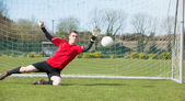 Goalkeeper in red ready to make a save — Stock Photo