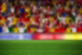 Blurry football pitch with crowd — Stok fotoğraf