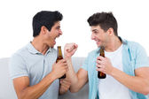 Happy football fans cheering together with beers — Stock Photo