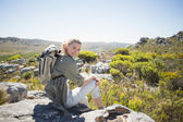 Hiker sitting at the summit — Stock Photo