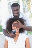 Man covering the eyes of his girlfriend — Stock Photo