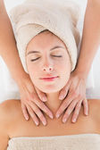 Attractive young woman receiving massage at spa center — Stock Photo