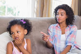 Pretty mother scolding petulant daughter — Stock Photo