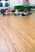 Yoga class stretching in fitness studio — Stock Photo