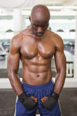 Muscular boxer standing in health club — Stock Photo