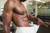 Muscular man in an over sized pants at gym — Stock Photo