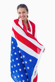 Pretty brunette wearing the american flag — Stock Photo