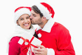 Attractive festive woman giving boyfriend present — Stock Photo