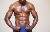 Shirtless young muscular man flexing muscles — Stock Photo