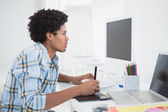 Young designer working at his desk with digitizer — Stock Photo