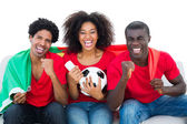 Cheering football fans in red  with portugal flag — Stock Photo