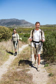 Happy hiking couple walking on country trail — Stock Photo