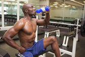 Muscular man drinking energy drink in gym — Foto de Stock