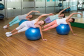 Fitness class on exercise balls in studio — Stock Photo