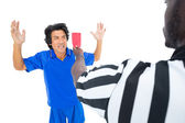 Serious referee showing red card to player — Stock Photo