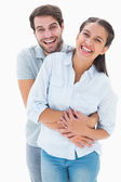 Cute couple hugging and smiling at camera — Stock fotografie