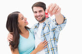 Happy young couple holding new house key — Stock Photo