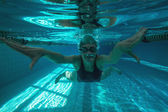 Athletic swimmer swimming towards camera — Stock Photo