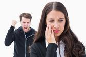 Unhappy brunette being threatened by boyfriend — Stock Photo