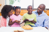 Happy family having breakfast together in the morning — Stock Photo